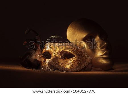 Two golden Venetian masks , focus on foreground. #1043127970