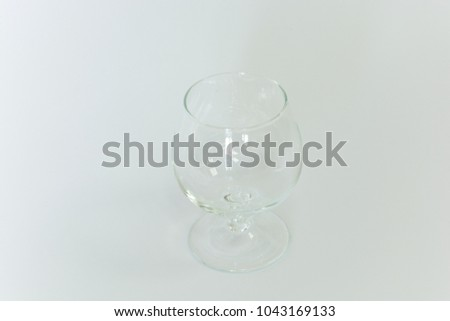 An empty cocktail brandy glass on a white background #1043169133