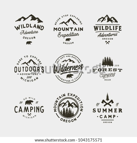 set of vintage wilderness logos. hand drawn retro styled outdoor adventure emblems, badges, design elements, logotype templates. vector illustration Royalty-Free Stock Photo #1043175571