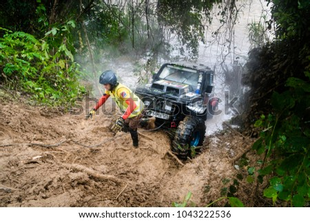 SG LEMBING, MALAYSIA - NOVEMBER 27, 2017: Rainforest Challenge Global Series Finals. Special stages of the offroad race in Sg Lembing on a rainy wet day #1043222536