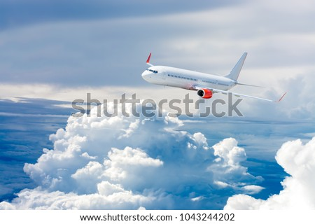White airplane flying above cloud