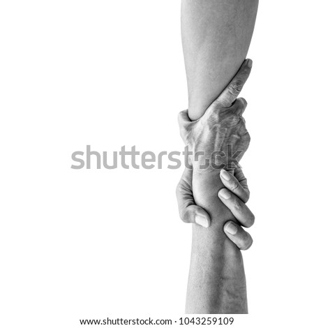 Vertical help hands holding together representing friendship, partnership, help and hope, donation, assistance. Dramatic monochrome black and white effect. Royalty-Free Stock Photo #1043259109