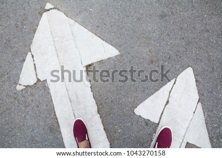 Shoes standing at the crossroad and get to decision which way to go. Two ways to choose concept. Royalty-Free Stock Photo #1043270158