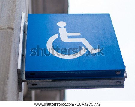 Wheelchair access sign for disabled #1043275972