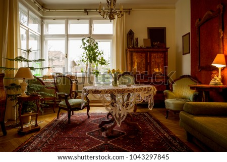 Old-fashioned sitting room with antique furniture Royalty-Free Stock Photo #1043297845