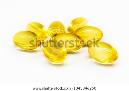 Close up of food supplement oil filled capsules suitable for: fish oil, omega 3, omega 6, omega 9, evening primrose, borage oil, flax seeds oil, vitamin A, vitamin D, vitamin D3, vitamin E #1043346250