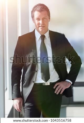 portrait of confident businessman on blurred background #1043516758