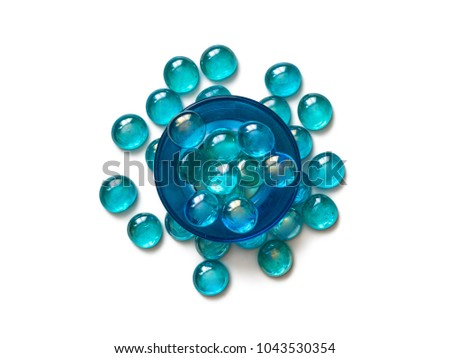 Blue glass candle holder and lampwork beads, aquamarine color, isolated white background #1043530354