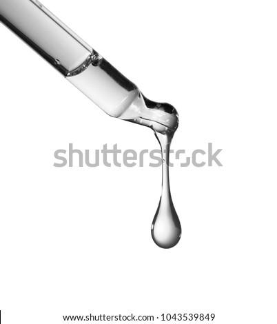 Liquid drop from laboratory glass Pipette #1043539849