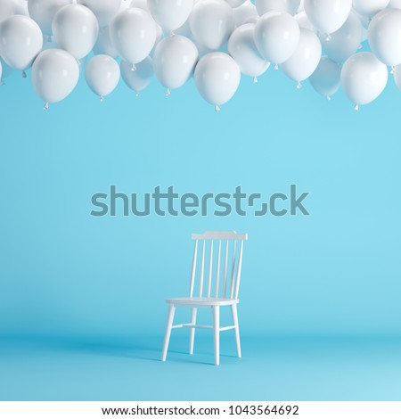 White chair with floating white balloons in blue background room studio. minimal idea creative concept. #1043564692