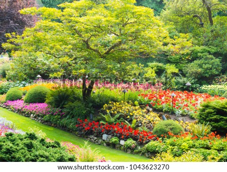 Colorful garden scenery in summer at Butchart Gardens, Victoria, British Columbia, Canada #1043623270