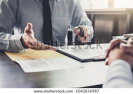 Businessman and Male lawyer or judge consult having team meeting with client, Law and Legal services concept. #1043656987