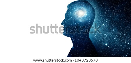 The universe within. Silhouette of a man with the space as a brain. The concept on scientific and philosophical topics.  Elements of this image furnished by NASA. #1043723578