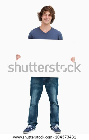 Male student holding a white board against white background #104373431