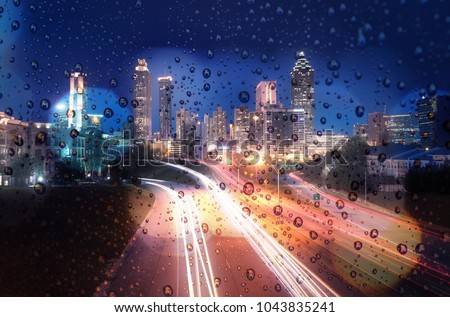 Blurred lights of city lights bokeh. City at night. Atlanta, USA #1043835241