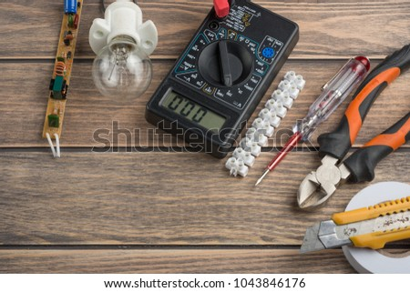 tools for electricians. On a wooden background. View from above, with space for writing or advertising #1043846176