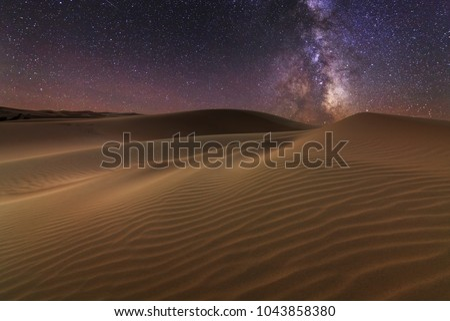 Amazing views of the Sahara desert under the night starry sky Royalty-Free Stock Photo #1043858380