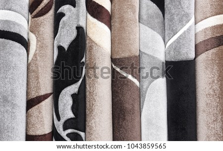 Carpets variety selection rolled up rugs shop store      #1043859565
