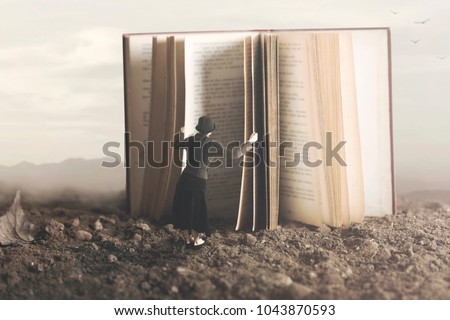 surreal image of a curious woman leafing through a giant book #1043870593