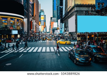 Famous Times Square landmark in New York downtown with mock up billboards for advertising and commercial information content. Big metropolis urban scene with development infrastructure with Lighboxes Royalty-Free Stock Photo #1043889826