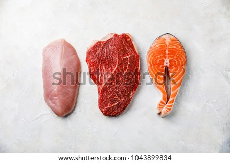 Raw food turkey breast, beef meat and Salmon oily fish steak on white textured background #1043899834