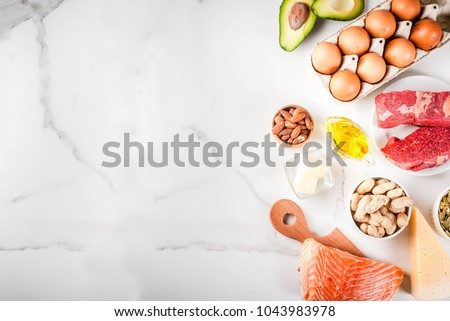 Ketogenic low carbs diet concept. Healthy balanced food with high content of healthy fats. Diet for the heart and blood vessels. Organic food ingredients, white marble background, copy space top view #1043983978