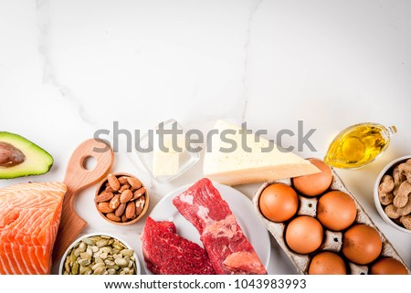 Ketogenic low carbs diet concept. Healthy balanced food with high content of healthy fats. Diet for the heart and blood vessels. Organic food ingredients, white marble background, copy space top view #1043983993