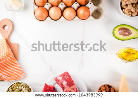 Ketogenic low carbs diet concept. Healthy balanced food with high content of healthy fats. Diet for the heart and blood vessels. Organic food ingredients, white marble background, copy space top view #1043983999