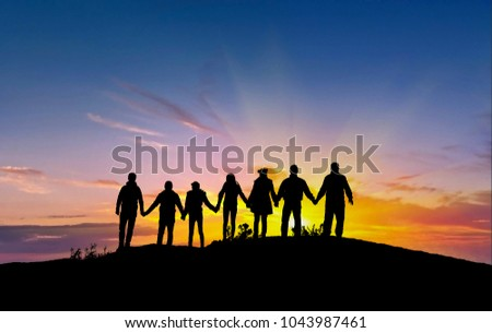 friends silhouette holding hand in hand Royalty-Free Stock Photo #1043987461
