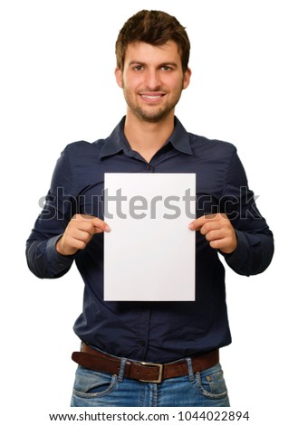 Young Man Holding Blank Paper On White Background #1044022894