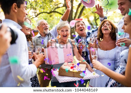Family celebration or a garden party outside in the backyard. Royalty-Free Stock Photo #1044048169