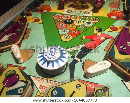 Close Up of Old Pinball Wizard Machine in Vivid Colorful Tone Royalty-Free Stock Photo #1044057793