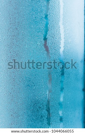 Background of natural water condensation, window glass with high air humidity, large drops drip. Collecting and streaming down #1044066055