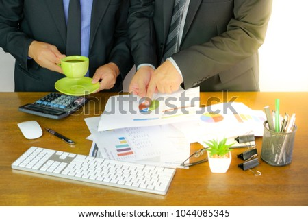 Businessman working with finances about cost and calculator budget #1044085345