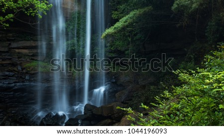 Beautiful waterfall at tropical rain forest #1044196093