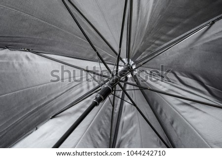 Open black umbrella, closeup #1044242710