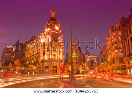 Madrid, Spain, 2018 March, 10. Gran Via Street after sunset with vehicles running through the street #1044255763
