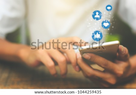 Young man using smart phone,Social media concept. #1044259435
