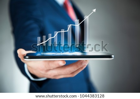 man hand tablet with graph in screen #1044383128
