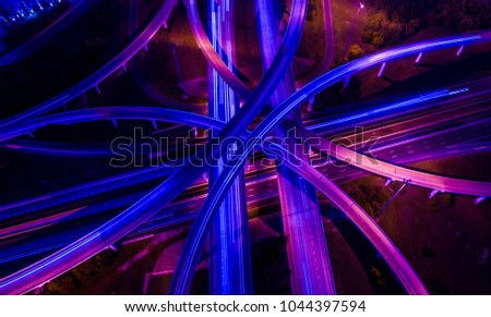 Violets , purples , and blues aerial drone straight down angle above highways and interchange overpass , a travel destination transportation Infrastructure new technology future scene #1044397594