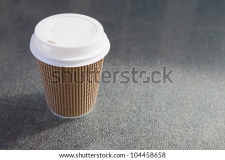 Cardboard throwaway coffee cup #104458658