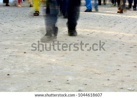 Pedestrians are walking on road in rush hour #1044618607