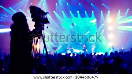 cameraman live streaming event production concert blurry defocus bokeh background #1044686479