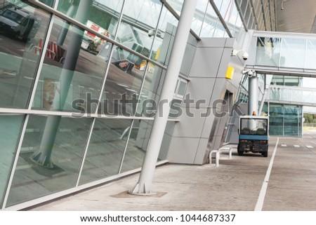 Modern reflective glass airport terminal building #1044687337