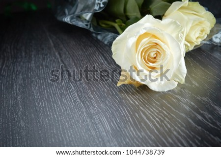 fresh white roses on a dark wooden background for postcard #1044738739