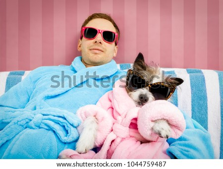 cool funny couple of   poodle dog  and owner  both resting and relaxing in   spa wellness salon center ,wearing a  bathrobe and fancy sunglasses, #1044759487