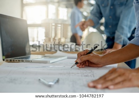 Architect Engineer Design Working on Blueprint Planning Concept. Construction Concept #1044782197