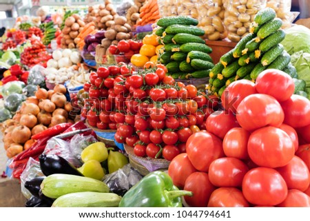tomatoes, cucumbers, peppers and other vegetables for sale on the market #1044794641