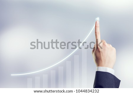 Hand of Businesswoman plan growth and increase of positive indicators in his business, Development and growth concept. #1044834232