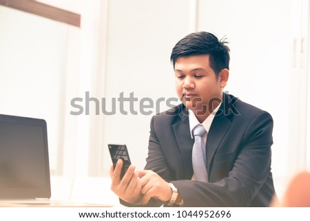 young business man using smart phone, business concept  #1044952696